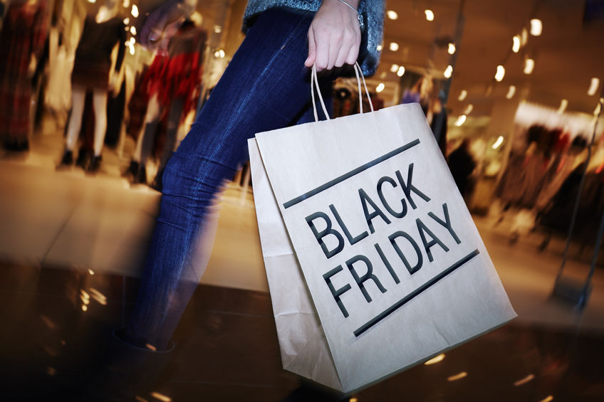 47782301 - modern shopper with black friday paperbag going in the mall